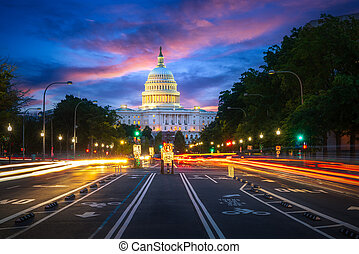 Capital building in Washington DC city at night wiht street and cityscape