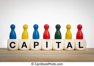 Capital concept with pawns - Capital concept: Pawns in...