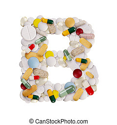 Capital letter B made of various colorful pills, capsules and tablets on isolated white background