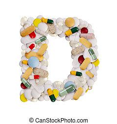 Capital letter D made of various colorful pills, capsules and tablets on isolated white background