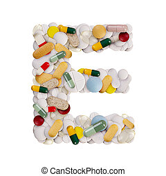 Capital letter E made of various colorful pills, capsules and tablets on isolated white background