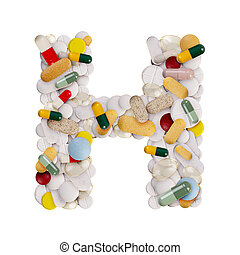Capital letter H made of various colorful pills, capsules and tablets on isolated white background