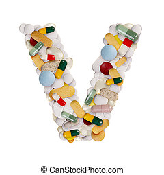 Capital letter V made of various colorful pills, capsules and tablets on isolated white background