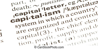 capitalism word on dictionary, extreme closeup