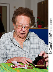 Old woman counts her money