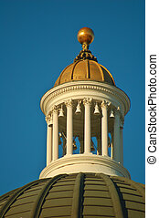 top of the California Capitol building in Sacramento illuminated by the afternoon sun