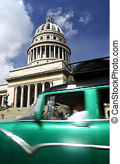 Capitolio and Car - Old American driving past the Capitlio ...