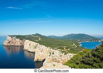 Capo Caccia under a blue sky