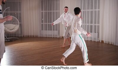 Capoeira. Two professional men training their skills at...