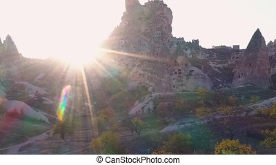 Cappadocia rocks in sunlight. Cave houses in the rock formations near Goreme, Turkey. Beautiful morning scene.