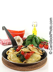 Cappelletti with tomatoes and basil - fresh Rocket and...