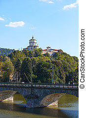 Cappuccini Mount or mount of Capuchin Monks church and bridge on Po river in a sunny summer day in Turin, Italy