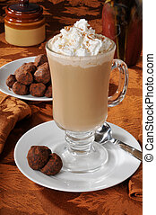 Cappuccino and tuffels - A cup of cappuccino with whipped...