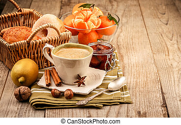 Cappuccino coffee in cup and fruits for breakfast