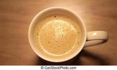 Cappuccino in a white cup - Cappuccino with foam in a white...