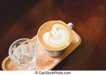 cappuccino latte art hot coffee on wooden table background - coffee cup top view