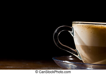 Cappuccino on wood table - photo of cappuccino in glass cup...