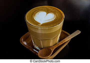 Cappuccino or latte coffee. - Close up cup of cappuccino or ...