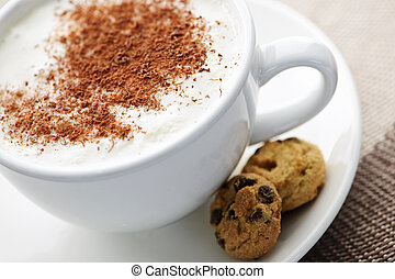 Cappuccino or latte coffee in cup with frothed milk and ...