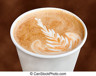 Closeup of cappuccino in a takeaway cup