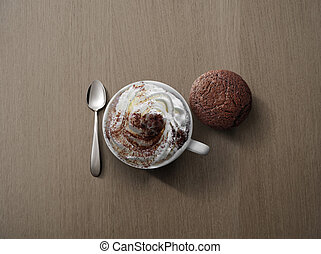 Cappucino with spoon, pastry on wooden background from above