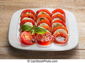 Caprese salad tomato mozzarella with basil