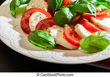 Caprese salad with mozzarella, tomato, basil