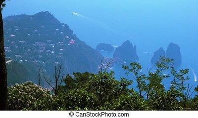 Capri island, Italy - Famous Faraglioni cliffs and beautiful...