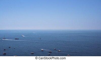 Capri island, Italy - Tyrrhenian Sea waters with boats and...