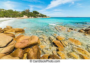 Capriccioli beach on a sunny day