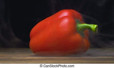 capsicum or sweet red bell pepper in cold, steam from frost...