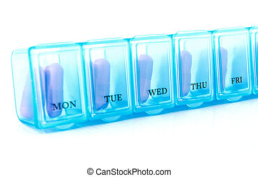 Capsule in blue daily pill box