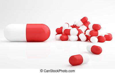Capsule pills, dosage - Red and white capsule pills on white...