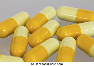 Capsule pills on white background