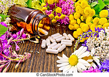 Capsules in brown jar with flowers on board