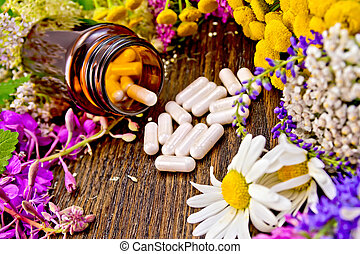 Capsules in open brown jar on board with flowers