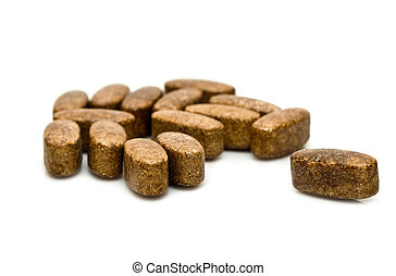 capsules of amino acid on a white background