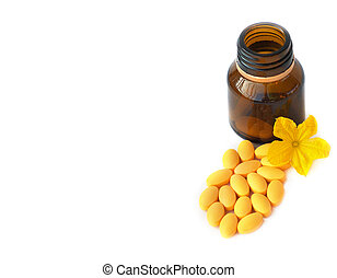 Capsules Pills Bio Medicine and Bottle with flower isolated on white background