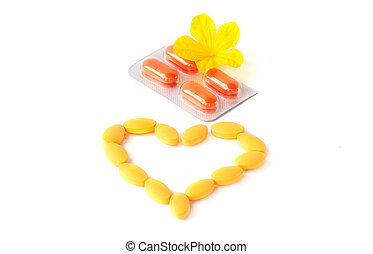 Capsules Pills Bio Medicine in Heart shape with flower isolated on white background