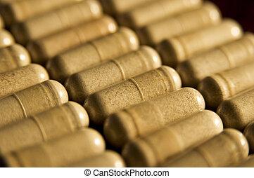 Capsules - Rows of capsules in soft light