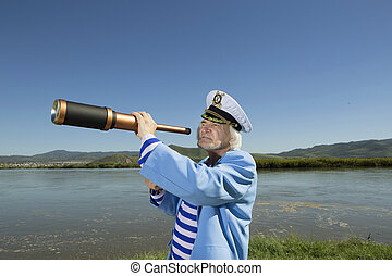 Captain looks through a telescope