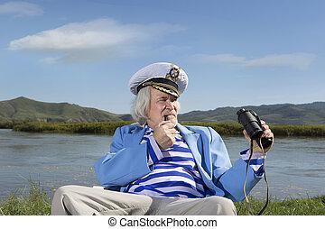 Captain looks through binoculars