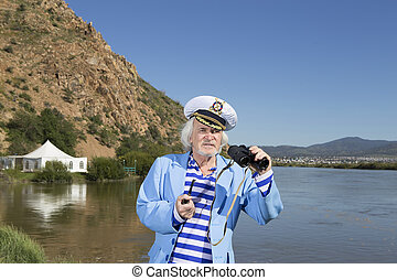 Captain looks through binoculars