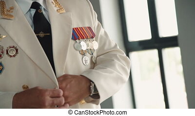 Captain of ship button white jacket uniform. Man sailor put on suit with medals. Senior veteran dress up. Concept nautical, navy, authority. Elder male seaman occupation