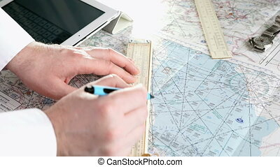 Captain of the aircraft plans a flight route - Captain of...