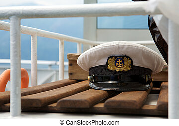 Captains cap on board on a wooden bench