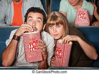 Captivated Couple in Theater