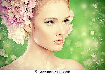 captivating glance - Beautiful girl with flowers in her...
