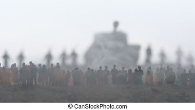 Captured by enemy concept. Military silhouettes and crowd on war fog sky background. World War Soldiers and armored vehicles movement while scared people watching. Artwork decoration. Selective focus