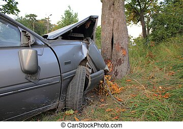 Car accident - Car destroyed in a crash with tree